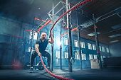 Men With Battle Rope Battle Ropes Exercise In The Fitness Gym. Crossfit Concept. Gym, Sport, Rope, T poster