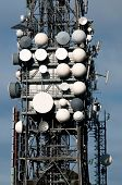 pic of telecommunications equipment  - Big television and radio tower with several parabolic antenna on high quote  - JPG