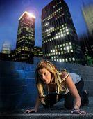 stock photo of hottie  - Fashion portrait of sexy female model with skyline urban background at night - JPG