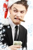 picture of hustler  - corporate suit man playing bad santa with snowflakes - JPG