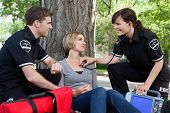 stock photo of triage  - Emergency medical professionals with a good assessment of a patient - JPG