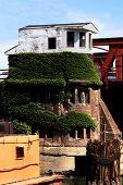 pic of gatekeeper  - Draw bridge gate house above a river  - JPG