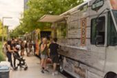 Abstract Blurred Food Truck Vendor With Customer Buy And Taste Variety Of Food poster