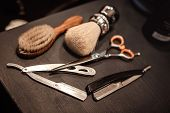 Shaving Accessories And Tools Of Barber Shop On Wooden Background poster