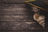 Pirate Captain Table Concept Background With Copy Space. Pirate Hat And Seashall On Old Wooden Board poster