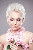 Photo Of A Beautiful Blond Woman With Flower. Closeup Attractive Sensual Face Of White Woman With Cu poster