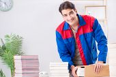 Worker in publishing house preparing book order poster