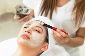 Beautiful Woman Having A Facial Treatment At Spa. poster