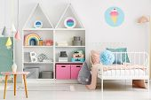 White Kids Room Interior With A Single Bed, Rainbow On The Shelf, Pompom And Ice Cream Poster On Th poster
