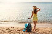 Beautiful Young Woman With A Hat Standing With Suitcase On The Wonderful Sea Background, Concept Of  poster