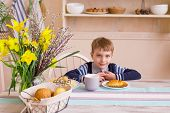 Little Boy Having Breakfast In The Kitchen. Breakfast Table With Boy. Child Have A Breakfast In The  poster