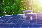Solar Panels On A Background Of Green Foliage And Sunlight. The Concept Of Renewable Energy, Environ poster