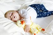 Cute Adorable Baby Girl Of 6 Months Sleeping Peaceful In Bed At Home. Closeup Of Beautiful Calm Chil poster