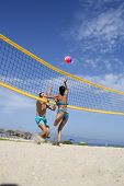 Woman And Man Fit, Strong, Healthy, Doing Sport On Beach. Beach Volleyball Concept. Couple Have Fun  poster
