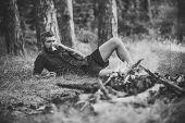 Man Traveler Drink Tea At Campfire Flame. Camping, Hiking, Lifestyle. Travel, Traveling, Wanderlust. poster