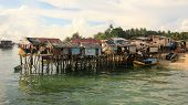 Poor fishing village at risk from climate change and rising sea levels poster