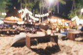 Blurred Background Of Beach Bar And Restaurant View At Night In Summer Vacation. Defocused And Bokeh poster