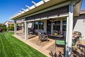 Modern Rear Yard Covered Patio With Furniture poster