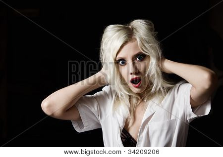 Beautiful Scared Young Girl In The Image Of Nurse On Black Background