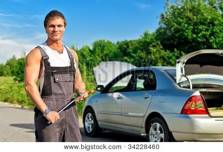 Handsome Mechanic On A Road Near The Broken Car