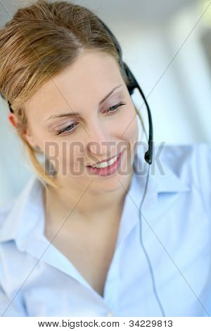 Closeup of attractive blond customer service assistant