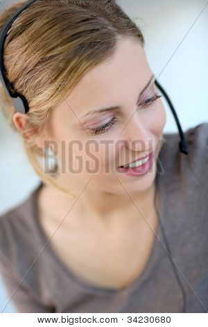 Closeup of beautiful blond teleoperator