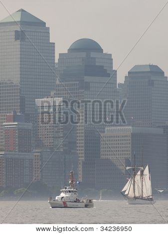 HOBOKEN, NJ -  MAY 23: USCGC Hammerhead and tall ship Etoile (France) sail past the World Financial Center during the Parade of Sail on May 23, 2012 in Hoboken, NJ. The parade is the start of Fleet Week.