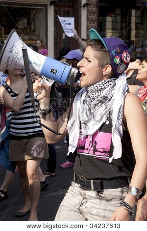NEW YORK - JUNE 22: A supporter leads a chant using a megaphone during the 8th Annual Trans Day of Action on June 22, 2012 in New York City.