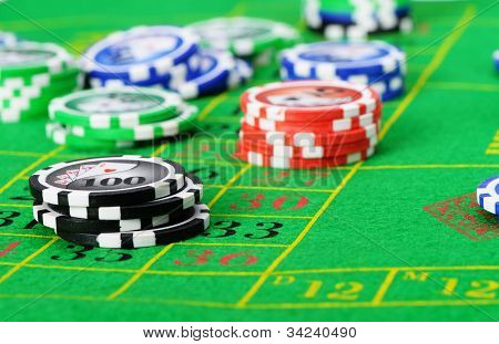 Gaming Chips On The Green Cloth