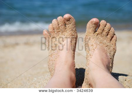 Feet And Sea Sand