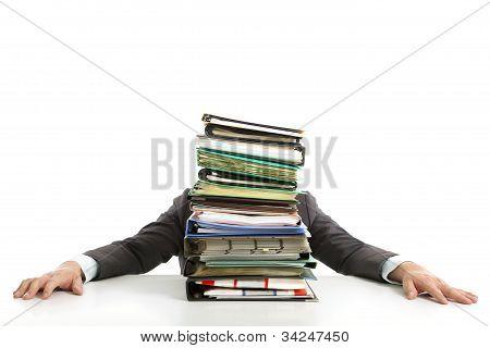 tired Businessman hiding behind paperwork