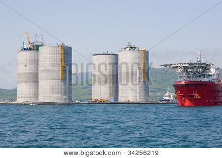 Base oil drilling platform and ocean-going tug. Sea of Japan. Russian coast.