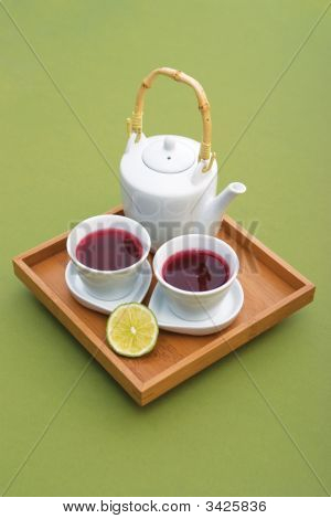 Tea Serving With Two Cups, Teapot And Lemon On Wooden Tray