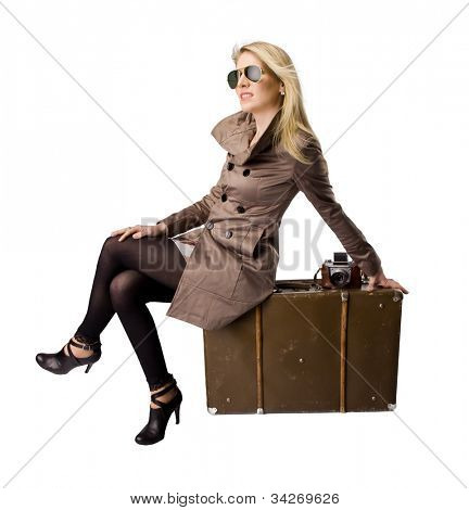 Beautiful blond young woman with suitcase, dressed in retro style. Isolated on white background