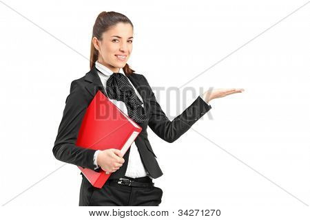 A young businesswoman holding a folder and gesturing isolated on white background