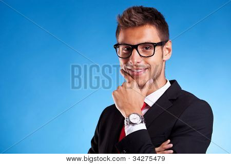 Closeup of a Pensive young business man on blue background