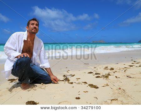 Man at beach kneeling