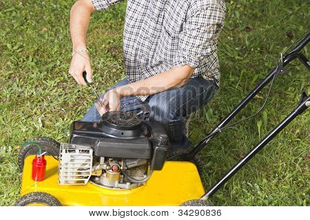 Repairing yellow lawn mover