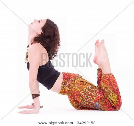 Hippie young woman doing yoga exercise