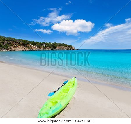 Cala Llenya in Ibiza kayak with turquoise water in Balearic islands