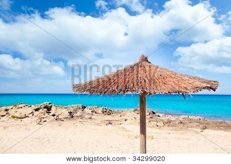 Balearic Formentera island with umbrella dried grass sunroof in mediterranean