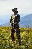 Focus And Concentration Experienced Hunter. Ready To Shoot. Army Forces. Man Military Clothes With W poster