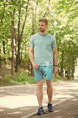 Outdoor Sport Training. Handsome Man In Sport Wear Walking On Natural Landscape. Athletic Sportsman  poster