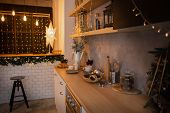New Years Kitchen Interior, Christmas Wreath Hanging On The Kitchen Wall. Christmas Decoration Of Th poster