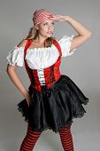 stock photo of wench  - Beautiful sexy blond woman wearing pirate costume - JPG