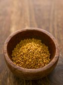 image of fenugreek  - close up of a bowl of fenugreek seeds - JPG