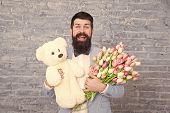 Nice Bouquet. Flower For March 8. Love Date. International Holiday. Bearded Man With Tulip Bouquet A poster