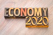 economy 2020 word abstract in vintage letterpress wood type, business finance concept poster