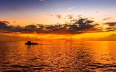 Amazing Sunset At Indian Ocean Golden Hour Image Near Maldive Island Boat Sailing Along Its Journey  poster