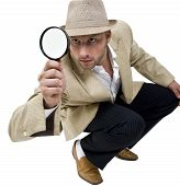 Man With Fedora Hat And Magnifier